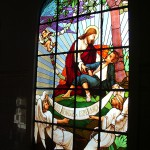 Stained glass window depicting Christ bringing hope to the leprosy affected