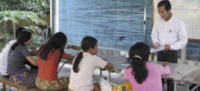 Leng Sophea gives a Khmer lesson to young women who have had reconstructive hand surgery.
