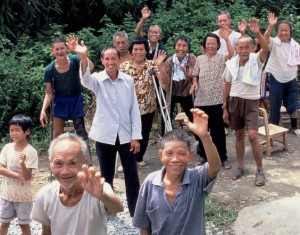 Residents of Teng-Qiao village in Guangdong Province bid farewell to volunteers at the end of a JIA work camp.