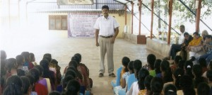 Standing tall: Nilkanth Koli addresses youth camp participants at Shantivan.