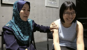 Nurul (left) pictured with younger sister Esther in Japan on October 24.