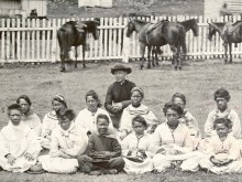 Father Damien with the Kalawao Girls Choir in the 1870s. (Hawaii State Archives)